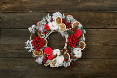 Christmas wreath on wooden background. Christmas wreath on the brown wooden rustic background Stock Photography