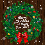 Christmas wreath on wooden background Royalty Free Stock Images