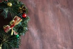 Christmas wreath in the wooden background. Copy space area royalty free stock image