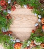 Christmas wreath on wooden background in a frame. Christmas wreath on wooden background  fir equipment pine decorative frame design good winter merry spruce royalty free stock photos
