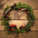 Christmas wreath on the wooden background Royalty Free Stock Image