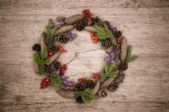 Christmas wreath on the wooden background Royalty Free Stock Photography