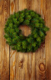Christmas wreath on wooden background. Christmas green wreath from firs brunches without decoration on wooden background with copy space stock image