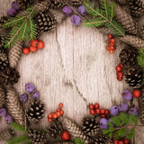 Christmas wreath on the wooden background Stock Images