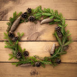 Christmas wreath on the wooden background Stock Image