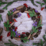 Christmas wreath on the wooden background Stock Photography