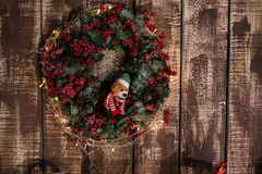 Christmas wreath on the wooden background Stock Photo