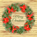 Christmas wreath on a wooden background Stock Image