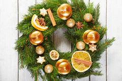 Christmas wreath on the wooden background Stock Photos