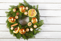 Christmas wreath on the wooden background Royalty Free Stock Photo