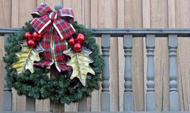 Christmas Wreath on a Wooden Balcony. A beautifully decorated Christmas Wreath displayed on a Wooden Balcony Stock Photos