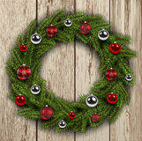 Christmas wreath on wooden board background Royalty Free Stock Image