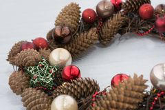 Christmas wreath on wooden board. Close up Royalty Free Stock Photography