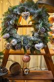 Christmas wreath with cones and Christmas toys on a wooden structure. stock photo