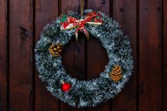 Christmas wreath. On a wooden door stock photography
