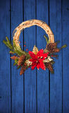 Christmas wreath on wooden door Stock Images