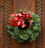 Christmas wreath on wooden door decoration Royalty Free Stock Photography