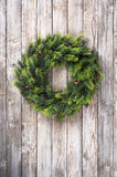Christmas wreath on wooden door Royalty Free Stock Image