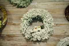 Christmas wreath on a wooden door, New Year`s garland Stock Image