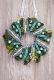 Christmas wreath on wooden door, space for your text Stock Image