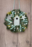 Christmas wreath on wooden door, space for your text Royalty Free Stock Photography