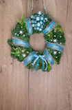 Christmas wreath on wooden door, text space Stock Image