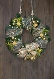 Christmas wreath on wooden door Stock Photos