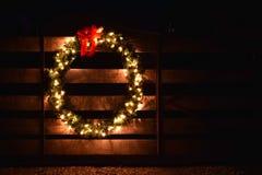 A Christmas wreath on a wooden farm gate. A horizontal of a Christmas wreath on a wooden farm gate stock photography