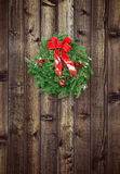 Christmas wreath on wooden fence Stock Image