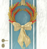 Christmas wreath. Wooden home door decorated with christmas wreath for the holiday Royalty Free Stock Photography