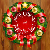 Christmas wreath on wooden planks background Royalty Free Stock Photo