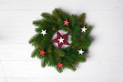 Christmas wreath with stars stock image