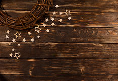 Christmas wreath with wooden stars on  rustic background. Stock Photos