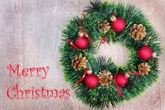 Christmas wreath on a wooden table. Christmas greeting card stock image