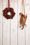 Christmas wreath on wooden wall. Christmas wreath hanging on wooden wall with copy space Stock Photo