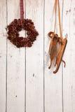 Christmas wreath on wooden wall Stock Photo