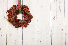 Christmas wreath on wooden wall Royalty Free Stock Images