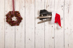 Christmas wreath on wooden wall Royalty Free Stock Photography