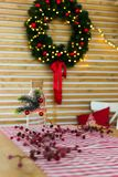 Christmas wreath on the wooden wall in the kitchen table checkered tablecloth decorated glass bottle of berries. new. Year 2019 royalty free stock images