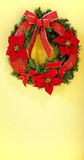 Christmas wreath on yellow background Stock Images