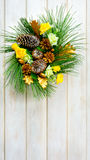 Christmas wreath with yellow fabric roses and golden pinecones Royalty Free Stock Images