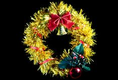 Christmas wreath. Yellow Christmas wreath with a red bow. insulation Royalty Free Stock Photos