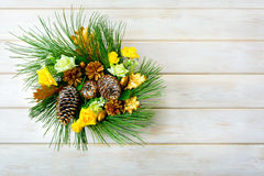 Christmas wreath with yellow silk roses and golden pinecones Stock Photo