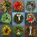 Christmas wreaths. Colorful holiday wreaths on doors, each one is unique royalty free stock images