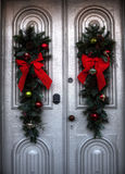 Christmas wreaths on a door. Christmas wreaths with red ribbons on a door Stock Photos