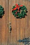 Christmas Wreaths. Green Christmas Wreaths on Vintage Wood Doors Stock Images