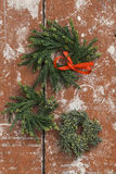 Christmas wreaths made from pine twigs on wooden table Royalty Free Stock Image