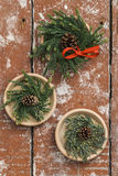 Christmas wreaths made from pine twigs on wooden table Stock Photos