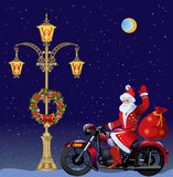 Christmas Wreaths and Santa on motorbike Royalty Free Stock Photos