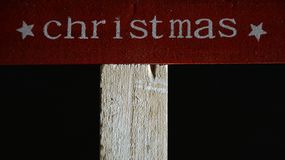 Christmas written on an wooden board royalty free stock photos